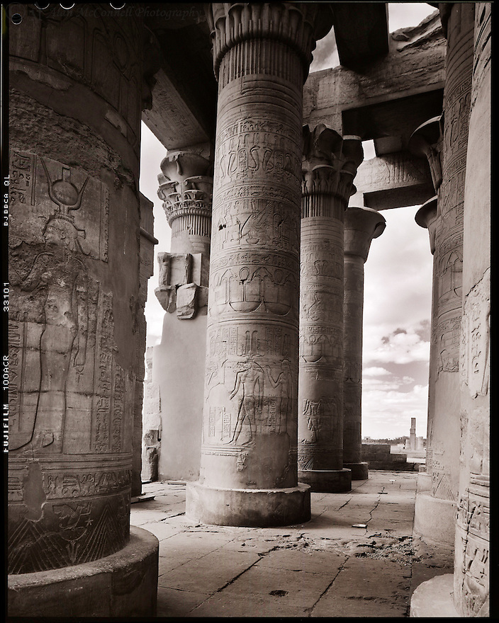 """""""Temple of Isis""""<br /> Temple of Philae<br /> Agilika Island, Egypt<br />  2011<br /> <br /> The Temple of Isis is the main building of the Philae Temple complex.  After visitors disembark from boats, they walk along a courtyard flanked by colonnades leading to the temple.  The huge temple has scenes of Ptolemy XII massacring his enemies as watched by Isis, Osiris, and Hathor.<br /> <br /> <br /> 4 x 5 Large Format Film"""