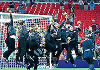 August 09, 2012: US women's team celebrate during post game award ceremony at the Wembley Stadium on day thirteen in Wembley, England. USA defeat Japan 2-1 to win it's third consecutive Olympic gold medal in women's soccer. ..