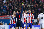 Atletico de Madrid´s Diego Godin, Koke and Mario Suarez argue with the referee who shows a yellow card to Godin during 2014-15 `Copa del Rey´ Spanish Cup match at Vicente Calderon stadium in Madrid, Spain. January 07, 2015. (ALTERPHOTOS/Victor Blanco)