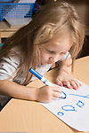Education preschool 4 year olds girl writing letters with marker