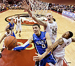 Duke's Austin Rivers (0) drives to the bucket between FSU's Jon Kreft (50) and Xavier Gibson (1) 15th ranked Florida State Seminoles falls 74-66 to the 4th ranked Duke Blue Devils in an NCAA basketball game in Tallahassee, Florida November 23, 2010.
