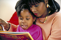 African-american mother and child read together