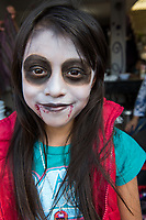 Mexico, Mixquic. Day of the Dead, Dia de los Muertos. Girl with face paint costume.