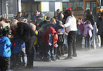 Students duck from blowing snow and sand as Santa arrives on a Careflight helicopter at the 11th annual Holiday with a Hero at Walmart in Carson City, Nev., on Wednesday, Dec. 16, 2015. <br /> Photo by Cathleen Allison