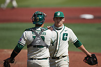 Charlotte 49ers relief pitcher Christian Lothes (27) is greeted by catcher Aaron McKeithan (12) after closing out the win over the Old Dominion Monarchs at Hayes Stadium on April 25, 2021 in Charlotte, North Carolina. (Brian Westerholt/Four Seam Images)