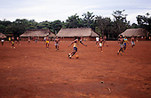 A-Ukre village, Brazil. Football game in a Kayapo Indian village; looking through the goal; Xingu Indigenous Area, Para State.