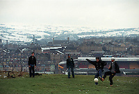 Pix:Michael Steele/SWpix...Soccer. Asian soccer, Bradford...COPYRIGHT PICTURE>>SIMON WILKINSON..Asian lads play soccer on the hills above Bradford City's Valley Parade ground.