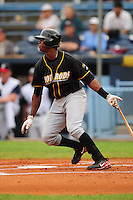 June 4, 2009  Shortstop Tim Beckham (26) of the Bowling Green Hot Rods swings at a pitch during a game at McCormick Field Asheville nc Bowling Green is the South Atlantic League League Low A affiliate of the Tampa Bay Rays.  Photo By Tony Farlow/Four Seam Images.
