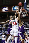 SIOUX FALLS, SD - MARCH 6: Tamell Pearson #2 of the Western Illinois Leathernecks tries to block Tasos Kamateros #34 of the South Dakota Coyotes during the Summit League Basketball Tournament at the Sanford Pentagon in Sioux Falls, SD. (Photo by Richard Carlson/Inertia)