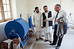 2 June 2013,  Jalalabad, Afghanistan.   Abdul Mohammad Saber (right) Chacellor of Nangarhar University in Jalalabad speaks with Naeem Jan Sawary (centre), Vice Chancellor of Student Affairs and Khalid Abdurahim of the Engineering Faculty in a laboratory on site. Many of the facilities and equipment at the University are being provided under the World Bank funded Strengthening Higher Education Program ( SHEP). The objective of the program is to restore basic operational performance at a group of core universities in Afghanistan. It aims to act as a catalyst to attract resources at Afghan tertiary education in the long term.  SHEP is the first major education investment in Afghanistan by the World Bank. In 2008 it received $US 5 million from ARTF to expand infrastructure and equipment to Universities in Kabul, Nangarhar , Balkh and Kandahar.  Picture by Graham Crouch/World Bank