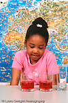 Piaget conservation of liquid preoperational child girl viewing short wide glasses with equal amounts of liquid
