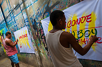 "Colombian sign painters write with a brush while working on music party posters in the sign painting workshop in Cartagena, Colombia, 17 April 2018. Hidden in the dark, narrow alleys of Bazurto market, a group of dozen young men gathered around José Corredor (""Runner""), the master painter, produce every day hundreds of hand-painted posters. Although the vast majority of the production is designed for a cheap visual promotion of popular Champeta music parties, held every weekend around the city, Runner and his apprentices also create other graphic design artworks, based on brush lettering technique. Using simple brushes and bright paints, the artisanal workshop keeps the traditional sign painting art alive."