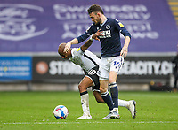 3rd October 2020; Liberty Stadium, Swansea, Glamorgan, Wales; English Football League Championship, Swansea City versus Millwall; Andre Ayew of Swansea City and Scott Malone of Millwall jostle for possession