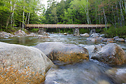 Footbridge, which cross Franconia Brook along the Lincoln Woods Trail in Lincoln, New Hampshire. Old abutments from Trestle No. 7 of the the East Branch & Lincoln Railroad (1893-1948) are used to support this bridge. Hikers enter into the Pemigewasset Wilderness on the right-hand side of this bridge.