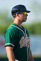Greensboro Grasshoppers manager Kevin Randel (26) coaches third base during the South Atlantic League game against the Hickory Crawdads at L.P. Frans Stadium on May 6, 2015 in Hickory, North Carolina.  The Crawdads defeated the Grasshoppers 1-0.  (Brian Westerholt/Four Seam Images)