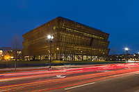 Traffic creates light trails at twilight outside the Smithsonian National Museum of African American History and Culture in Washington, DC.