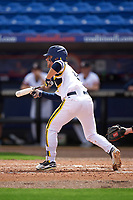 Michigan Wolverines shortstop Michael Brdar (9) squares to bunt during the first game of a doubleheader against the Canisius College Golden Griffins on June 20, 2016 at Tradition Field in St. Lucie, Florida.  Michigan defeated Canisius 6-2.  (Mike Janes/Four Seam Images)