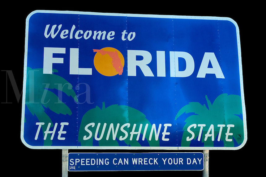 """Road sign reading """"Welcome to Florida ,the Sunshine State"""