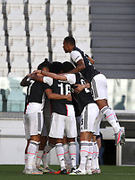Calcio, Serie A: Juventus - Torino, Turin, Allianz Stadium, July 4, 2020.<br /> Juventus' Paulo Dybala celebrates after scoring with his teamates during the Italian Serie A football match between Juventus and Torino at the Allianz stadium in Turin, July 4, 2020.<br /> UPDATE IMAGES PRESS/Isabella Bonotto