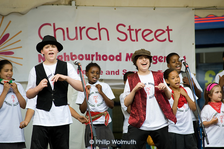 The cast from Oliver perform at Church Street Summer Festival 2009, organised by Church Street Neighbourhood Forum.