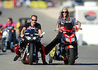 Oct. 27, 2012; Las Vegas, NV, USA: NHRA pro stock motorcycle rider Matt Smith with wife Angie Smith during qualifying for the Big O Tires Nationals at The Strip in Las Vegas. Mandatory Credit: Mark J. Rebilas-