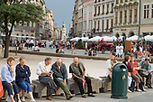 Local Poles and tourists in the medieval main square of Krakow.