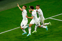 Nicolo Barella of Italy celebrates with Federico Chiesa and Marco Verratti after scoring the goal of 0-1 during the Uefa Euro 2020 round of 8 football match between Belgium and Italy at football arena in Munich (Germany), July 2nd, 2021. Photo Matteo Ciambelli / Insidefoto