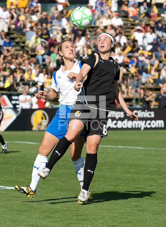 Nancy Augustyniak (25) and Tiffany Weimer (8) battle for the ball. FC Gold Pride defeated the Boston Breakers 2-1 at Buck Shaw Stadium in Santa Clara, California on April 5th, 2009. Photo by Kelley Cox /isiphotos.com
