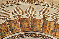 Pictures of an apse Roman mosaics design depicting a peacock spreading its tail feathers between two winged angels or cupids holding long candle sticks, from the Maison du Paon in the ancient Roman city of Thysdrus. 3rd century AD. El Djem Archaeological Museum, El Djem, Tunisia.