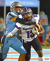 Fort Smith Southside's Cole Elwonger, left, tackles Fayetteville's Omar Murray (13) on Friday, Oct. 8, 2021 in Fort Smith. (Special to NWA Democrat Gazette/Brian Sanderford)