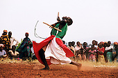 Burundi. Drummer holding drum sticks and dancing; from a traditional Burundi group.