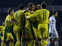 12.12.2013 London, England. Anzhi Makhachkala defender Ewerton (37) celebrates his goal with teammates during the Europa League game between Tottenham Hotspur and Anzhi Makhachkala from White Hart Lane.