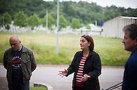 05.06.2013, Potocari ( Srebrenica ) Bosnia Herzegovina<br /> Memorial Centre Potocari<br /> Amra Begic (c) e' nata nel 1978 ed e' cresciuta a Sebrenica. Nel 1995 durante il massacro di Srebrenica era a Tuzla ed ha assistito alla televisione serba la preparazione del massacro operato dall'esercito serbo in presenza della forza internazionale dell'Onu che ha assistito senza intervenire. Dal 2002 Amra Begic e' tornata a Srebrenica e guida i turisti al Memorial Center. L'esercito Serbo nel 1995 ha massacrato a Srebrenica circa 8.000 tra uomini e ragazzi Musulmani, la piu' grande atrocita' commessa in Europa dalla seconda guerra mondiale. <br /> Foto Insidefoto / EXPA/ Juergen Feichter