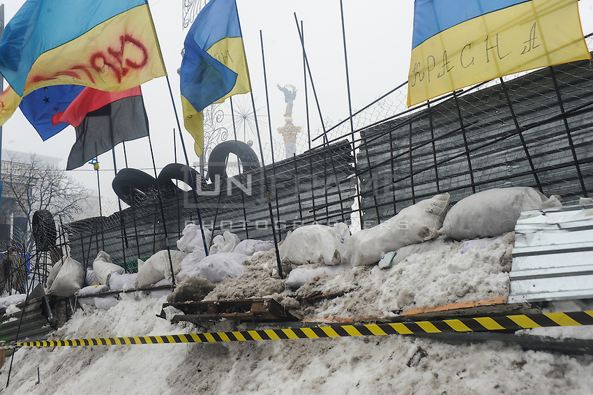 Protesters did not give up after the faint  attempt of evacuation performed by the police of the night before. Despite the adverse weather conditions,  they restored and rebuilt the complex structures of the  barricades under the snow in Maidan square. Kiev,  Ukraine.