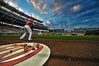 9 July 2011: Washington Nationals infielder Michael Morse stands on deck with Laynce Nix at bat against the Colorado Rockies at Nationals Park in Washington, District of Columbia. The Nationals were edged out by the Rockies 2-1, dropping the second game of their 3-game series. Mandatory Credit: Ed Wolfstein Photo
