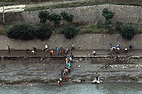 "North Koreans collecting water from a river in the North Korean country-side. North Korea is one of the last great dictatorships where, ""Dear Leader"" Kim-Jong-il and his father Kim Il-sung ""Great Leader"" are worshipped and there is complete control of people who are constantly reminded of the evil deeds of the the west and USA."