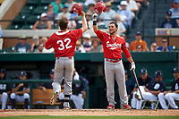 Florida Southern Moccasins David Lugo (right) congratulates Sam Machonis (32) after hitting a home run during an exhibition game against the Detroit Tigers on February 29, 2016 at Joker Marchant Stadium in Lakeland, Florida.  Detroit defeated Florida Southern 7-2.  (Mike Janes/Four Seam Images)