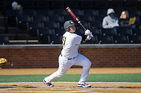 Walker Haymaker (11) of the VCU Rams hits a solo home run to right field against the Georgetown Hoyas at Wake Forest Baseball Park on February 13, 2015 in Winston-Salem, North Carolina.  The Rams defeated the Hoyas 6-3.  (Brian Westerholt/Four Seam Images)