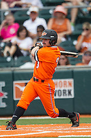Oklahoma State Cowboys outfielder Saulyer Saxon #3 follows through on his swing during the NCAA baseball game against the Texas Longhorns on April 26, 2014 at UFCU Disch–Falk Field in Austin, Texas. The Cowboys defeated the Longhorns 2-1. (Andrew Woolley/Four Seam Images)