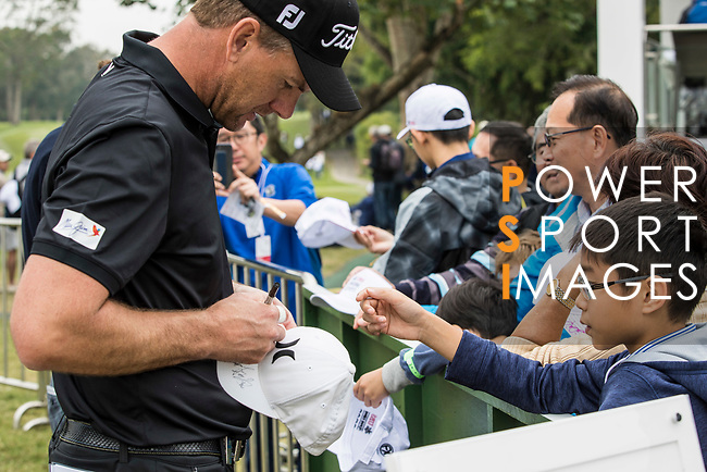 A player signs autograph for the ittle golf fans during the day three of UBS Hong Kong Open 2017 at the Hong Kong Golf Club on 25 November 2017, in Hong Kong, Hong Kong. Photo by Yu Chun Christopher Wong / Power Sport Images