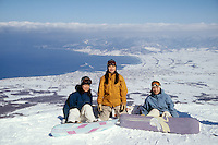 Three female snowbaorder on top of a mountain