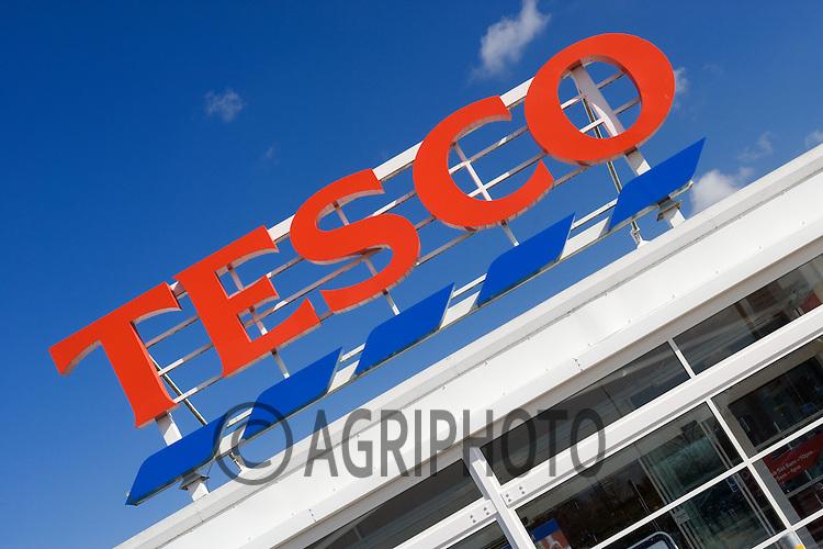 Tesco Supermarket Store Sign Against A Deep Blue Sky