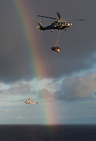 101224-N-7981E-253 PACIFIC OCEAN (Dec. 24, 2010)- HH-60H Seahawks assigned to Helicopter Anti-Submarine Squadron (HS) 15 pass a rainbow while delivering mail to the aircraft carrier USS Carl Vinson (CVN 70) from the fleet replenishment oiler USNS Henry J. Kaiser (T-AO 187) during a vertical replenishment at sea. Carl Vinson and Carrier Air Wing (CVW) 17 are on a deployment to the U.S. 7th and U.S. 5th Fleet areas of responsibility. (U.S. Navy photo by Mass Communication Specialist 2nd Class James R. Evans / RELEASED)