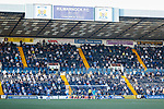 Fans in the Chadwick Stand watch as Euan Murray of Kilmarnock heads wide of the Ayr goal. Kilmarnock 2 Ayr United 0, Scottish Championship, August 2nd 2021. Following Kilmarnock's relegation in 2020-21, the first game of the new season is the Ayreshire Derby, the first league match between the teams in 28 years. Due to relaxation of Covid restrictions the match was played in front of a crowd of 3200 Kilmarnock fans. The game was shown live on BBC Scotland.