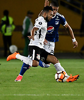 BOGOTA - COLOMBIA – 28 - 02 - 2018: Matias de los Santos (Der.) jugador de Millonarios (COL), disputa el balon con Clayson (Izq.) jugador de Corinthians (BRA), durante partido entre Millonarios (COL) y Corinthians (BRA), de la fase de grupos, grupo 7, fecha 1 de la Copa Conmebol Libertadores 2018, en el estadio Nemesio Camacho El Campin, de la ciudad de Bogota. / Matias de los Santos (R) player of Millonarios (COL), figths for the ball with Clayson (L) player of Corinthians (BRA), during a match between Millonarios (COL) and Corinthians (BRA), of the group stage, group 7, 1st date for the Conmebol Copa Libertadores 2018 in the Nemesio Camacho El Campin stadium in Bogota city. VizzorImage / Luis Ramirez / Staff.