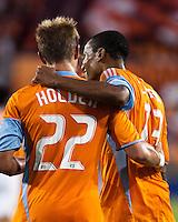 Houston Dynamo midfielders Stuart Holden (22) and Ricardo Clark (13) celebrate Clark's 37th minute goal.  Houston Dynamo defeated Chicago Fire 3-2  at Robertson Stadium in Houston, TX on August 9, 2009.