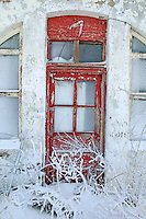 Red door on abandoned building in Brothers, Oregon