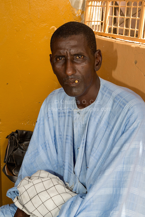 Senegal, Saint Louis.  A Pular-speaking Senegalese from the Fouta Jalon.  He has a chewing stick in his mouth, for cleaning teeth.