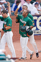 Zeke DeVoss #7 of the Miami Hurricanes celebrates his 9th inning grand slam against the Boston College Eagles at the 2010 ACC Baseball Tournament at NewBridge Bank Park May 27, 2010, in Greensboro, North Carolina.  The Eagles defeated the Hurricanes 12-10 in 10 innings.  Photo by Brian Westerholt / Four Seam Images