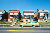 St. Louis: Shotgun houses in a section of  St. Louis called The Hill. Neat, small houses on small lots. Photo '80.